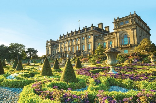 View of the historic Harewood House, a Georgian house built in the late 18th century and the formal Terrace gardens created by Sir Charles Barry in the 1840s in summer.