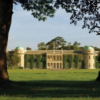 Goodwood House through the trees credit Goodwood Collection